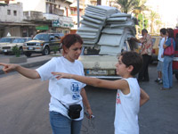 Bilal with Zeina Allouche, director of SOS Children's Villages Lebanon - Photo: SOS Archives