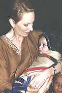 Princess Salimah Aga Khan with a child from the Camp Badaber - Photo: SOS Archives