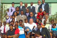 Mr Blatter and other visitors with group of SOS children and mothers - Photo: SOS Archives