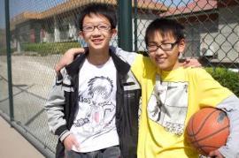 Siblings playing basketball (photo: SOS archives)