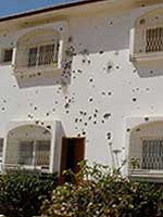 Some buildings in SOS Children's Village Rafah are covered with bullet holes - Photo: SOS Archives
