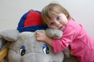 Girl hugging a soft toy elephant (Photo: K. Ilievska)
