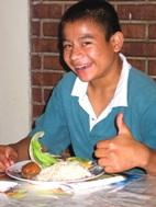 Héctor enjoys his Auntie's cooking (Photo: M. Jaramillo)