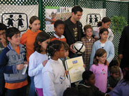 Pauleta surrounded by SOS children in Bicesse - Photo: SOS Archives
