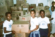 Helping to distribute supplies - Photo: SOS Archives