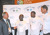 R. Pichler from SOS-Kinderdorf International, Roger Milla, Lucas Radebe and Craig Forrest (left to right)